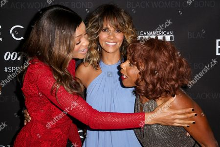 "Naomie Harris, from left, Halle Berry and Gloria Hendry arrive at ""Spectre"" - The Black Women Of Bond Tribute at the California African American Museum, in Los Angeles"