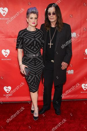 Kelly Osborne, left, and Ozzy Osbourne attend the 10th annual MusiCares MAP Fund Benefit Concert at Club Nokia on in Los Angeles