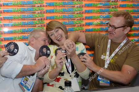 "From left, Adam Reed, Amber Nash and Matt Thompson attend the FX ""Archer"" booth signing on Day 2 of Comic-Con International on in San Diego, Calif"