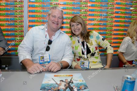 "Adam Reed, left, and Amber Nash attend the FX ""Archer"" booth signing on Day 2 of Comic-Con International on in San Diego, Calif"