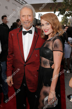 Clint Eastwood and Erica Piccininni attend the Warner Bros. Premiere of 'Jersey Boys' at the 2014 Los Angeles Film Festival held at Regal Cinemas LA Live Stadium 14, in Los Angeles
