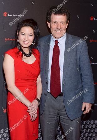 Stock Picture of Journalists Sheryl WuDunn and Nicholas Kristof attend the 2nd Annual Save the Children Illumination Gala at The Plaza Hotel, in New York