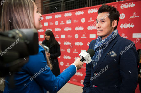 """Stock Photo of Actor Arifin Putra is interviewed at the premiere of the film """"The Raid 2"""" during the 2014 Sundance Film Festival,, in Park City, Utah"""