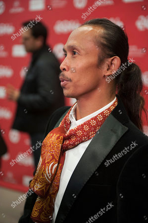 "Actor Yayan Ruhian speaks during an interview at the premiere of the film ""The Raid 2"" during the 2014 Sundance Film Festival,, in Park City, Utah"