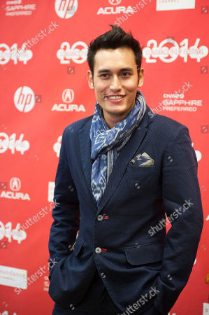 """Actor Arifin Putra poses at the premiere of the film """"The Raid 2"""" during the 2014 Sundance Film Festival,, in Park City, Utah"""