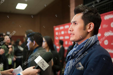 """Actor Arifin Putra is interviewed at the premiere of the film """"The Raid 2"""" during the 2014 Sundance Film Festival,, in Park City, Utah"""