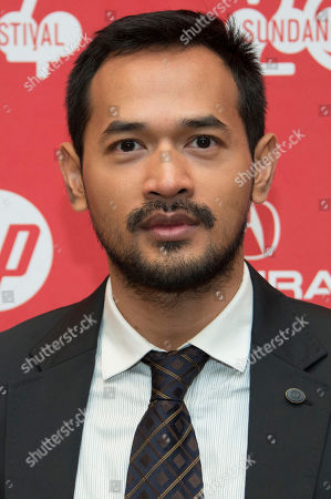 """Stock Picture of Actor Donny Alamsyah poses at the premiere of the film """"The Raid 2"""" during the 2014 Sundance Film Festival,, in Park City, Utah"""