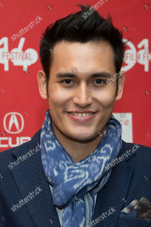 """Stock Image of Actor Arifin Putra poses at the premiere of the film """"The Raid 2"""" during the 2014 Sundance Film Festival,, in Park City, Utah"""