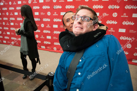 "Actor Yayan Ruhian pretends to choke reporter Michael Dalton at the premiere of the film ""The Raid 2"" during the 2014 Sundance Film Festival,, in Park City, Utah"