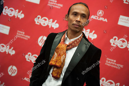 "Actor Yayan Ruhian poses at the premiere of the film ""The Raid 2"" during the 2014 Sundance Film Festival,, in Park City, Utah"