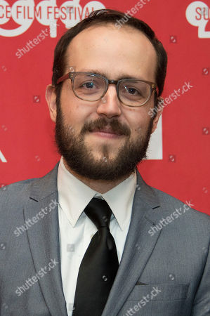 """Composer Joseph Trapanese poses at the premiere of the film """"The Raid 2"""" during the 2014 Sundance Film Festival,, in Park City, Utah"""