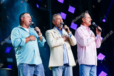 From left, Steve Gatlin, Larry Gatlin, and Rudy Gatlin of the Gatlin Brothers perform the National Anthem at LP Field at the CMA Music Festival, in Nashville, Tenn
