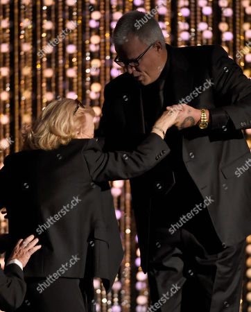 Gena Rowlands accepts an honorary Oscar at the Governors Awards at the Dolby Ballroom, in Los Angeles. From right, Son, Nick Cassavetes, helps her onstage