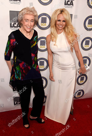 """Author Martha Grimes, left, recipient of the """"Sam Simon Award,"""" poses with Pamela Anderson, recipient of the """"Vegan of the Year"""" award, pose together at the 2015 Last Chance for Animals Annual Benefit at the Beverly Hilton, in Beverly Hills, Calif"""