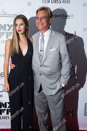 """Aaron Sorkin and daughter Roxy Sorkin, left, attend the New York Film Festival gala presentation of """"Steve Jobs"""" at Alice Tully Hall, in New York"""