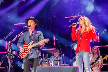 Clint Black, left, and Lisa Hartman Black perform at the CMA Music Festival at Nissan Stadium, in Nashville, Tenn. and