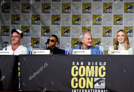 """Dominic Purcell, from left, Franz Drameh, Victor Garber,and Caity Lotz attend the """"Legends of Tomorrow"""" panel on day 3 of Comic-Con International, in San Diego"""