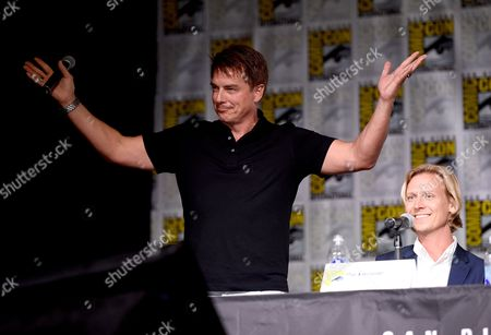 """John Barrowman, left, and Producer Phil Klemmer, attend the """"Legends of Tomorrow"""" panel on day 3 of Comic-Con International, in San Diego"""