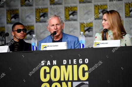"""Franz Drameh, from left, Victor Garber and Caity Lotz attend """"Legends of Tomorrow"""" panel on day 3 of Comic-Con International, in San Diego"""