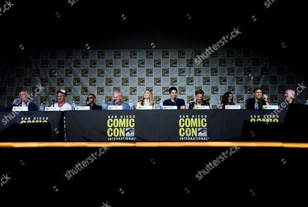 """Producer Phil Klemmer, from left, actors Dominic Purcell, Franz Drameh, Victor Garber, Caity Lotz, Brandon Routh, Arthur Darvill, Maisie Richardson-Sellers, Nick Zano, and producer Marc Guggenheim attend the """"Legends of Tomorrow"""" panel on day 3 of Comic-Con International, in San Diego"""