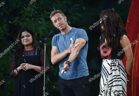 Member of Parliament from Mumbai North Central Poonam Mahajan, left, musician Chris Martin and actress Priyanka Chopra speak at the 2016 Global Citizen Festival in Central Park, in New York