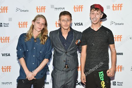 """Isaiah Stone, from left, McCaul Lombardi and Raymond Coalson arrive at the """"American Honey"""" premiere on day 4 of the Toronto International Film Festival at the Ryerson Theatre, in Toronto"""