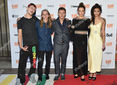 """Raymond Coalson, from left, Isaiah Stone, McCaul Lombardi, Riley Keough and Sasha Lane arrive at the """"American Honey"""" premiere on day 4 of the Toronto International Film Festival at the Ryerson Theatre, in Toronto"""