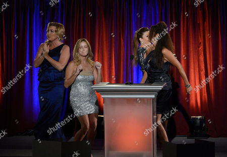 The Good News Girls, from left, Wendy Burch, of KTLA5, Dorothy Lucey, of The Good News Foundation, Ana Garcia, of The Good News Foundation, and Christine Devine, of KTTV/KCOP, speak on stage at the 65th Los Angeles Area Emmy Awards at the Leonard H. Goldenson Theatre, in Los Angeles