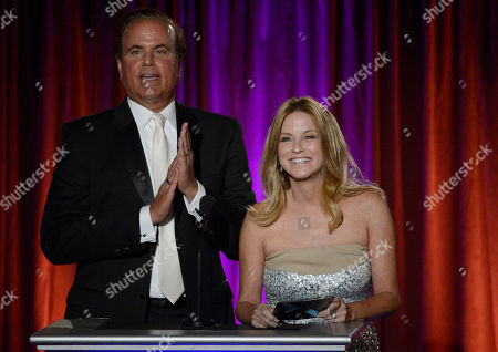Presenters David Goldstein, of CBS2 / KCAL9, left, and Dorothy Lucey, of The Good News Foundation, speak on stage at the 65th Los Angeles Area Emmy Awards at the Leonard H. Goldenson Theatre, in Los Angeles