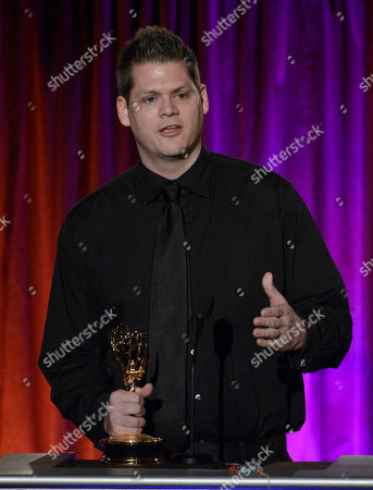 Jason Roberts, of KTLA5, accepts the award for outstanding videographer - news on stage at the 65th Los Angeles Area Emmy Awards at the Leonard H. Goldenson Theatre, in Los Angeles