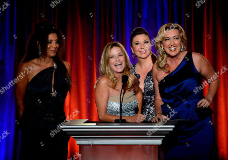 From left, Christine Devine, Dorothy Lucey, Ana Garcia and Wendy Burch present an award at the 65th Los Angeles Area Emmy Awards at the Leonard H. Goldenson Theatre, in Los Angeles