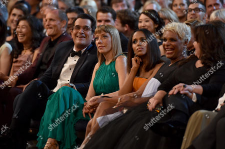Stock Photo of Ty Burrell, and from left, Holly Anne Brown, Kerry Washington, guest, Melissa McCarthy, and Ben Falcone in the audience at the 66th Primetime Emmy Awards at the Nokia Theatre L.A. Live, in Los Angeles