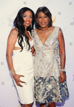 Areva Martin, left, and Pat Harvey arrive at the 67th Los Angeles Area Emmy Awards at the Skirball Cultural Center on