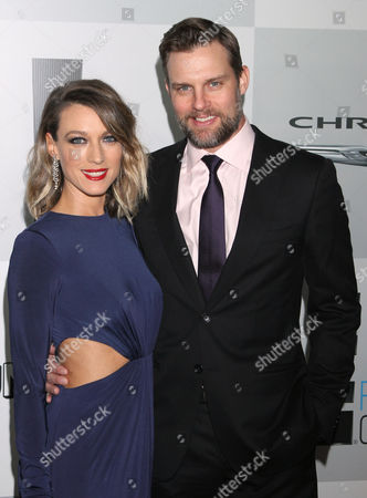 Natalie Zea, left, and Travis Schuldt arrive at the NBCUniversal Golden Globes afterparty at the Beverly Hilton Hotel, in Beverly Hills, Calif