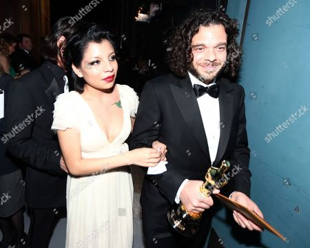 """Sean Fine, right, and Inocente Izucar are seen backstage with the award for best documentary short for """"Inocente"""" backstage at the Oscars at the Dolby Theatre, in Los Angeles"""