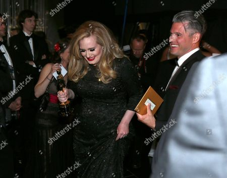 Singer/songwriter Adele and songwriter Paul Epworth seen backstage at the Oscars at the Dolby Theatre, in Los Angeles
