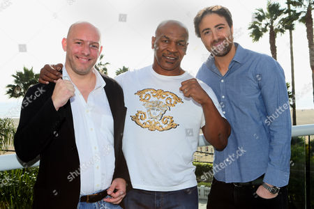 Laurence Gornall, and from left, Mike Tyson and Bert Marcus are seen at the 2014 American Film Market (AFM) at the Loews Santa Monica Hotel on in Santa Monica, Calif