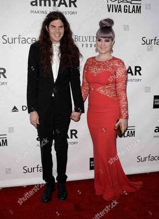 Stock Image of Singer Kelly Osbourne, right, and her boyfriend Matthew Mosshart arrive at the fourth annual amfAR Inspiration Gala at Milk Studios on in Los Angeles