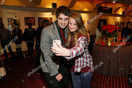"""Actor David Lambert poses for a photo with a fan during """"An Evening with the Fosters"""" presented by the Television Academy at the El Portal Theatre on in the NoHo Arts District in Los Angeles"""