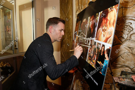 """Executive Producer, Showrunner and Co-Creator Bradley Bredeweg signs a poster at """"An Evening with the Fosters"""" presented by the Television Academy at the El Portal Theatre on in the NoHo Arts District in Los Angeles"""