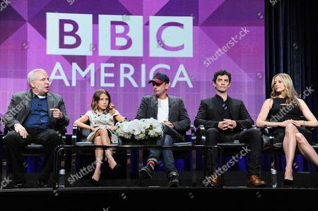 "From left, Glen Morgan, Millie Brown, John Simm, James Frain, Mira Sorvino, and director Eduardo Sanchez speak onstage during ""Intruders"" portion of the BBC America 2014 Summer TCA, in Beverly Hills, Calif"