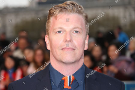 Actor David Menkin poses for photographers upon arrival at the premiere of the film 'A Hologram For The King' in London