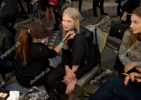Model Anna Jagodzinska has her make up prepared backstage ahead of the Temperley London show during London Fashion Week Spring/Summer 2014, at the Savoy Hotel in central London
