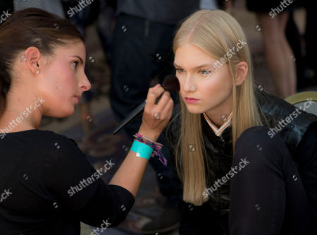 Stock Photo of Model Anna Jagodzinska has her make up prepared backstage ahead of the Temperley London show during London Fashion Week Spring/Summer 2014, at the Savoy Hotel in central London