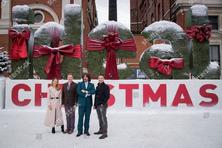 From left, Katie Piper, Olly Smith, Laurence Llewellyn-Bowen and Gino D'Acampo pose for photographers during a photo call in London