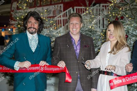 From left, Laurence Llewelyn-Bowen, Olly Smith and Katie Piper pose for photographers during a photo call in London