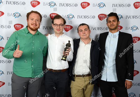 Stock Picture of Bombay Bicycle Club (L-R Jamie McColl, Jack Steadham, Ed Nash and Suren de Saram)with the 'Album' Award for 'So Long, See You Tomorrow' at the 60th Ivor Novello Awards at the Grosvenor House in London on