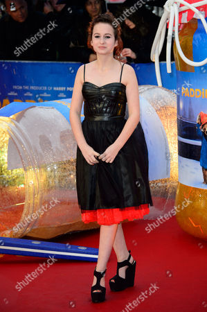 Madeleine Harris poses for photographers upon arrival at the world premiere of the film Paddington in London