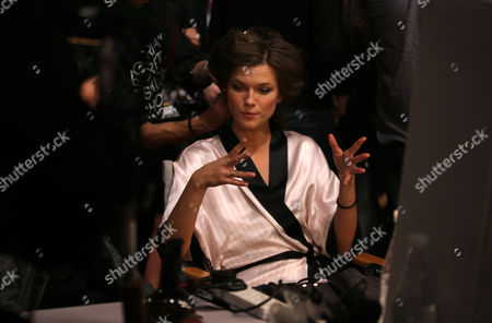 Model Kasia Struss talks to reporters backstage at the Victoria's Secret fashion show in London