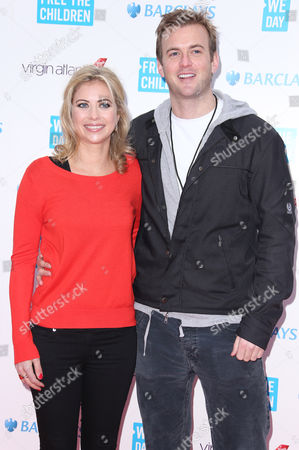 Stock Picture of Holly Branson and husband Fred Andrews arrive for We Day at Wembley Arena in west London, . Organized by international charity and educational partner, Free The Children, We Day is now a global event. Over 160,000 youths will come together in stadium gatherings to take part in an unprecedented educational initiative which inspires students to get involved in positive social change